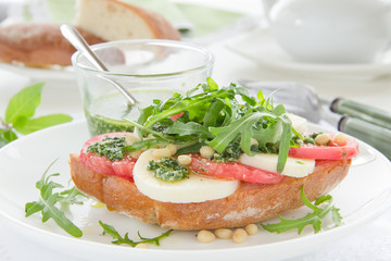 Ciabatta with tomato, mozzarella and rocket salad