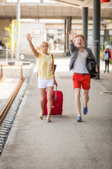 Young Couple Late at Train Station