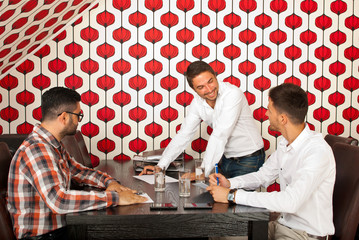 Men having happy discussion at meeting