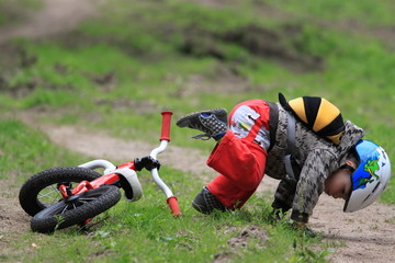 boy falling from bike