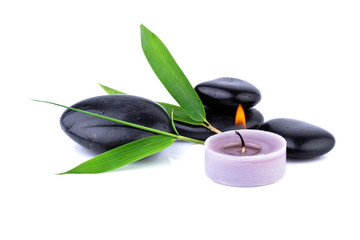 bamboo leaf and zen pebbles, candle over white, spa  concept