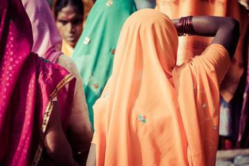 Women with colorful saris in Varanasi, India.