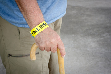 Fall Risk Bracelet And Wooden Cane