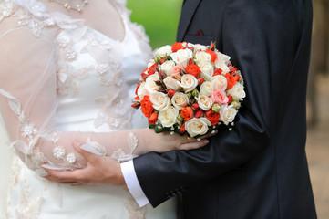 Bouquet and Wedding Hug