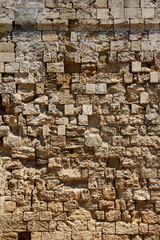 Old rough stone wall background