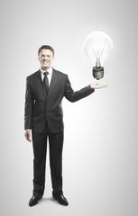 businessman holding lamp
