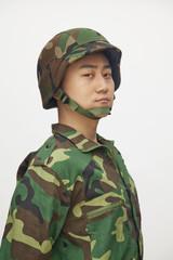 Portrait of man in military uniform, studio shot
