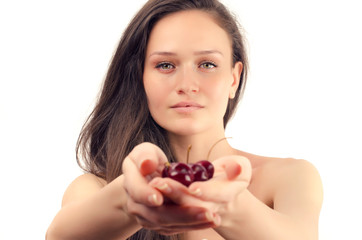 Beautiful woman posing with a cherry