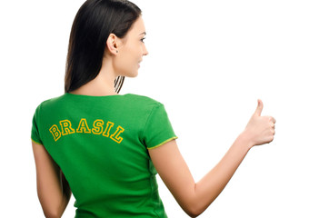 Thumbs up for Brazil.Girl with Brazilian flag on her t-shirt.