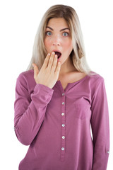 Surprised woman with hand on mouth