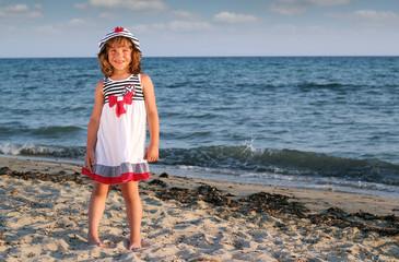 Wall Mural - beautiful little girl on beach summer scene