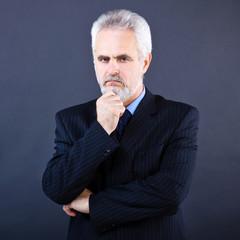 Studio shot of  business man on the dark background