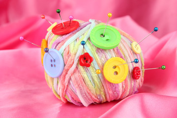 Colorful buttons and multicolor wool ball,