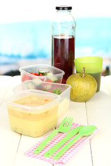 Tasty lunch in plastic containers,