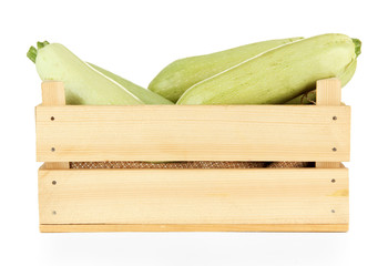 Fresh marrows in wooden box, isolated on white