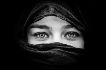 Portrait of beautiful woman with blue eyes wearing black scarf i