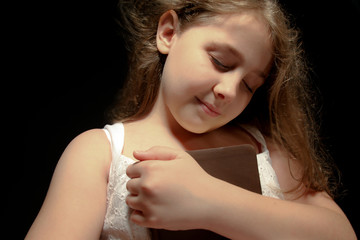 Young Girl Holding Bible