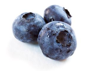 blueberries over white background