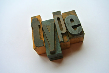 Type word composed with wooden typography
