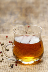Foto op Aluminium Alcohol Glass of hot steaming tea on wooden table