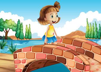 A little girl crossing the bridge