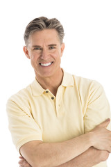 Portrait Of Happy Man Standing Arms Crossed