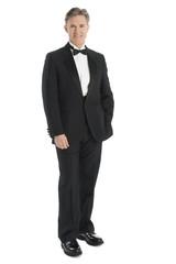 Portrait Of Mature Man Wearing Tuxedo Smiling