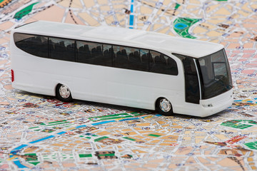 Mini bus on travel map background