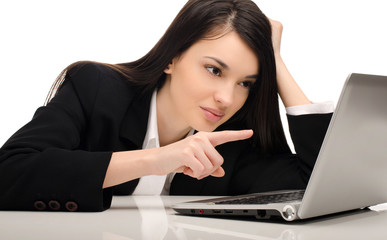Beautiful brunette businesswoman working on a laptop