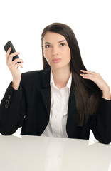 Beautiful business woman using a mobile phone at work