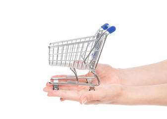 Hands giving empty shopping cart for sale