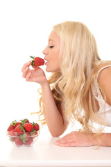sexy young blond girl eating a strawberry