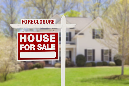 Foreclosure Home For Sale Sign in Front of House