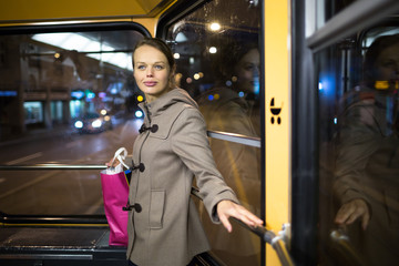 Pretty, young woman on a streetcar/tramway, during her evening c