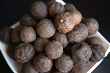 Black dried Lime or Lemon. Spice used in Middle Eastern dishes