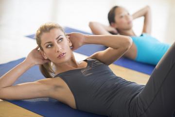 Woman Doing Sit-Ups At Gym