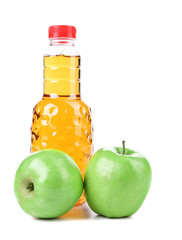 Apple juice in a bottle and ripe apples.
