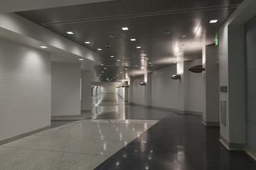A unique, empty hallway with minimal color.