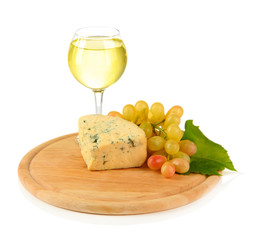 Glass of wine, tasty blue cheese and grape