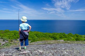 Child boy plans fishing