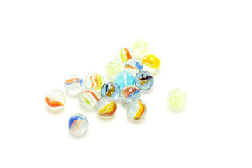 Some colourful marbles on white background