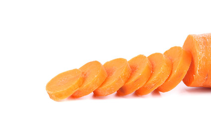 Raw carrot slices on a white background