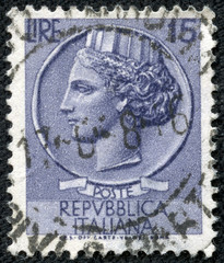 stamp shows a woman, who symbolize Italy after Syracusean Coin