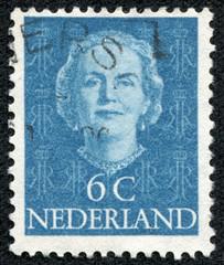 stamp printed in Netherlands, shows portrait of Queen Juliana