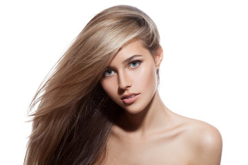 Wall Mural - Beautiful Blond Girl. Healthy Long Hair. White Background