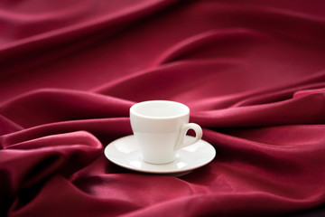 cup on a red silk