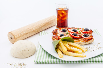 Pizza baguette with sausages and tomatos.