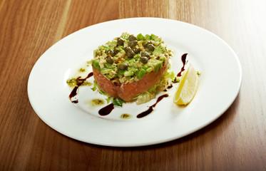 Salad with salmon with sauce.closeup