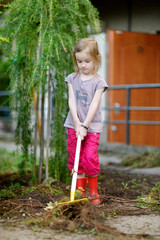 Little girl helping in a garden