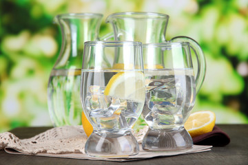 Glass pitchers of water and glasses